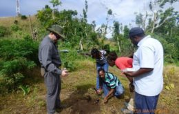 Collecting soil samples in Dominica. Image via Dominica Vibes.