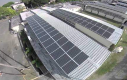 Photovoltaic panels line the roof of the Engineering Department at the University of Technology, Jamaica., Image via Jamaica Observer