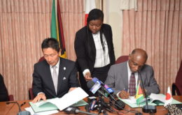 Guyana's Minister of Foreign Affairs, Carl Greenidge (right) and Ambassador of Japan to Guyana, His Excellency Mitsuhiko Okada (left) signing the grants. Image: via Stabroek News.