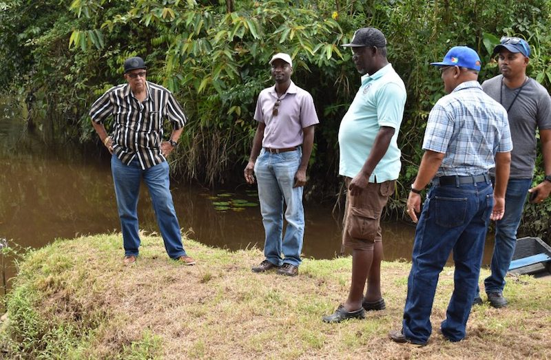 GWI officials at Kaituma river. Image: GWI via Stabroek News